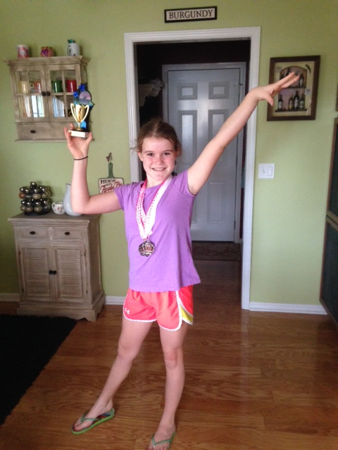 Madeline wins 1st Floor at ETC Gymnastics