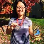 Ann Wins 6th Place for Gladstone Gators Swim Team Championship
