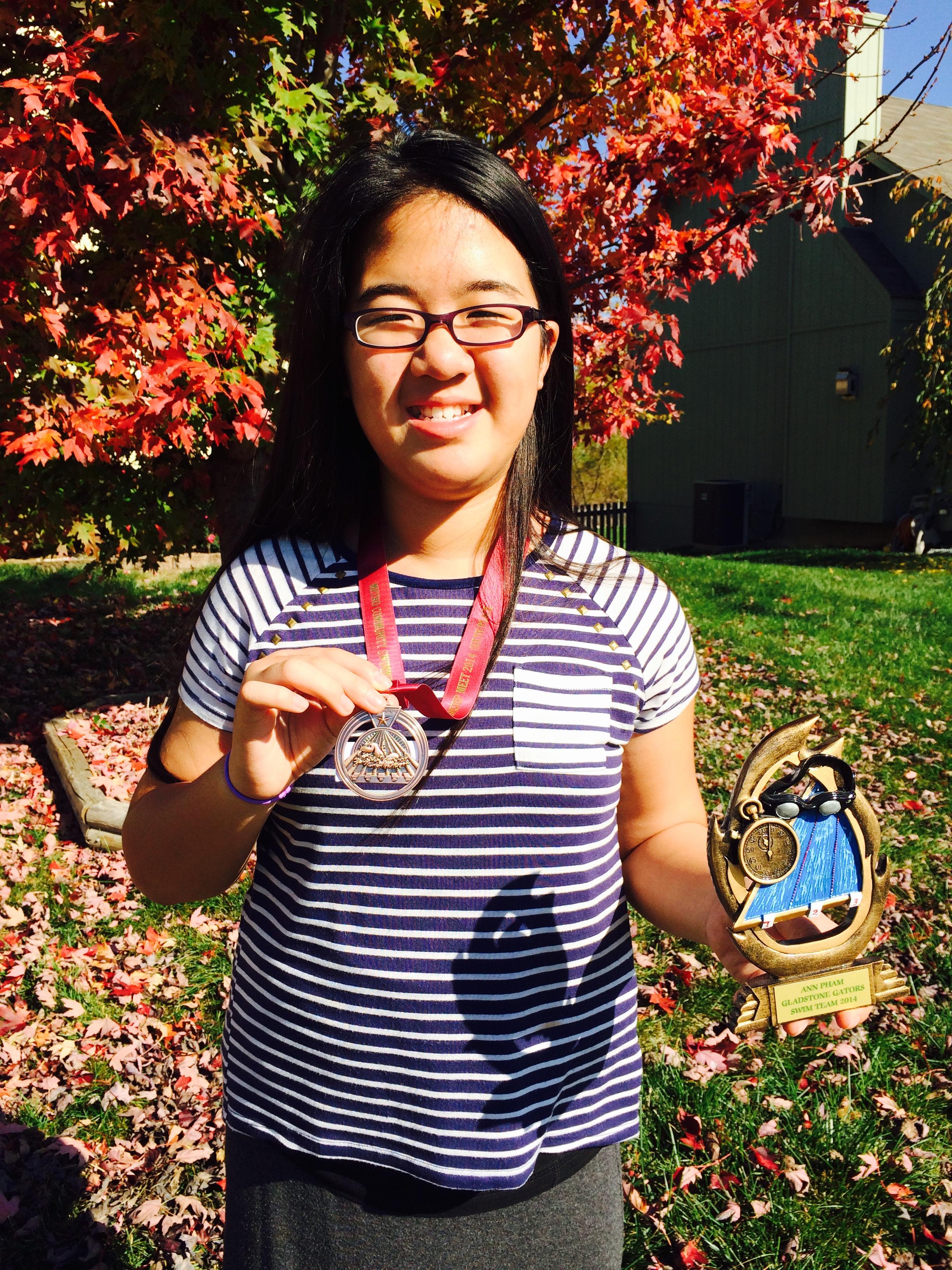Ann Wins 6th Place & Heat Winner for Gladstone Gators Swim Championship