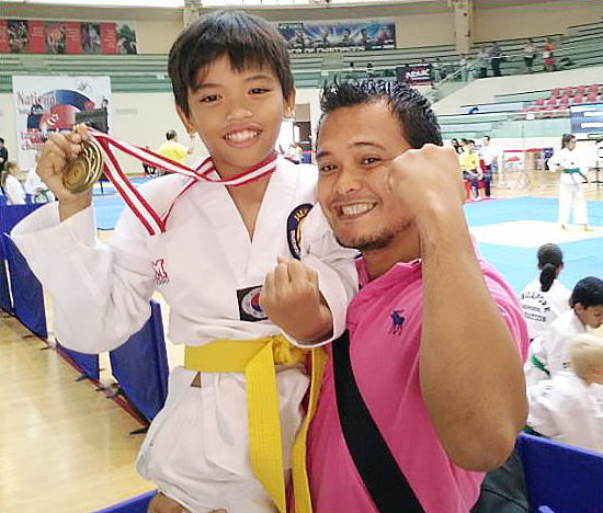 Elijah Wins 1st Place in International Taekwondo Championship
