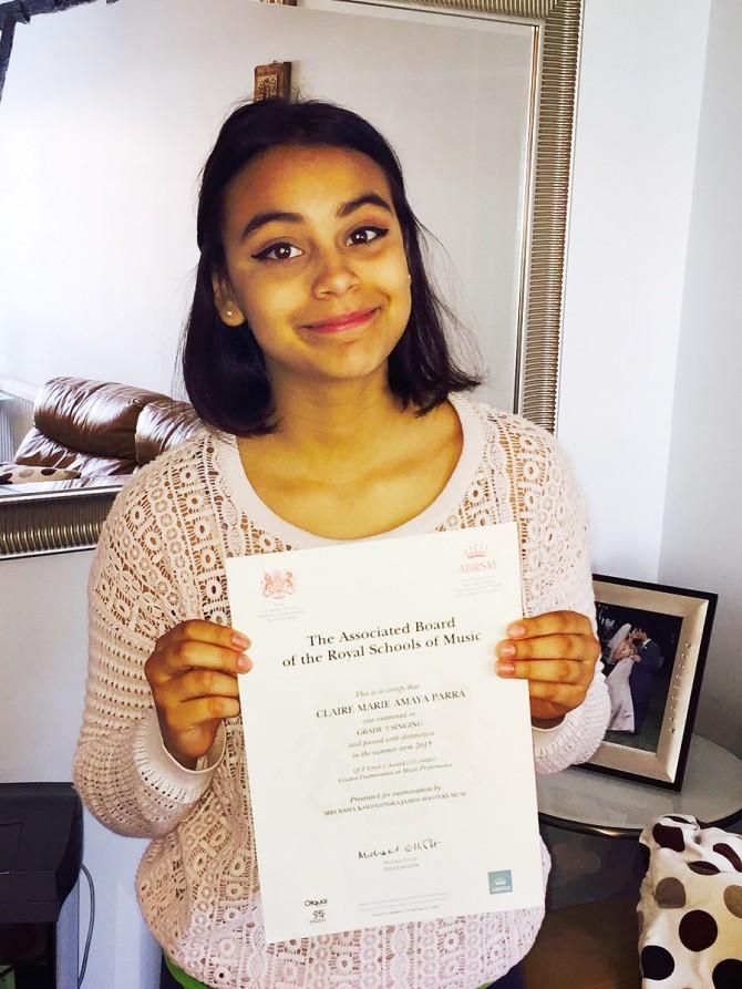 Claire Receives Distinction in Grade 3 Voice Exam