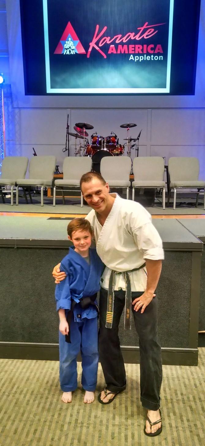 Simon earns 1st Degree Karate Black Belt