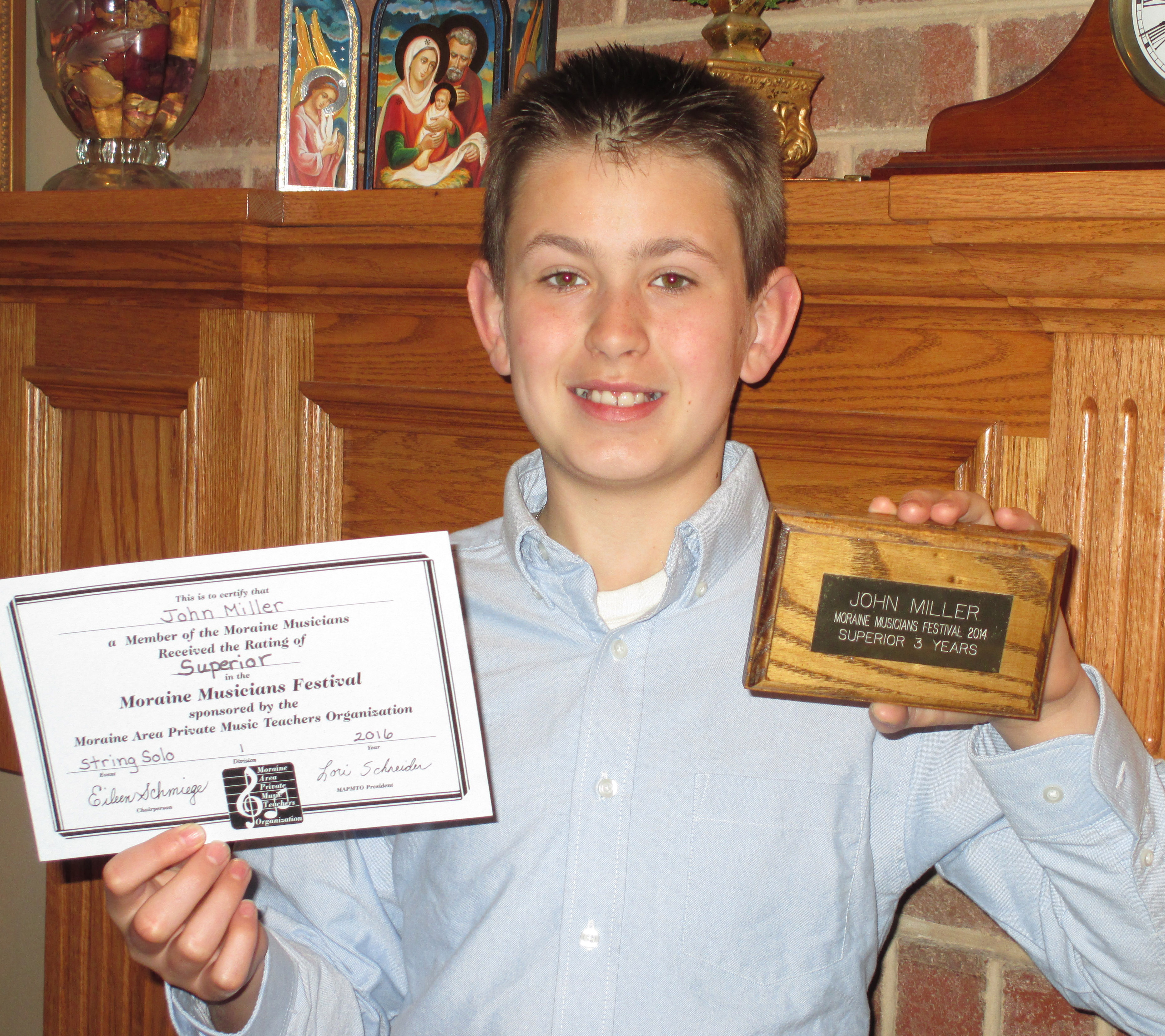 John Receives 5th Superior Rating for Violin Playing