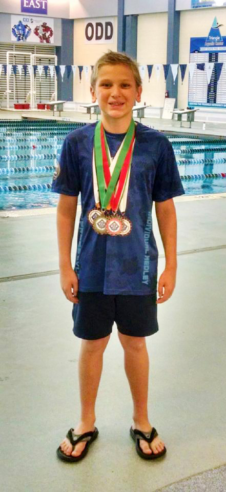 Thomas Wins 1st Place in 400 Meter Freestyle