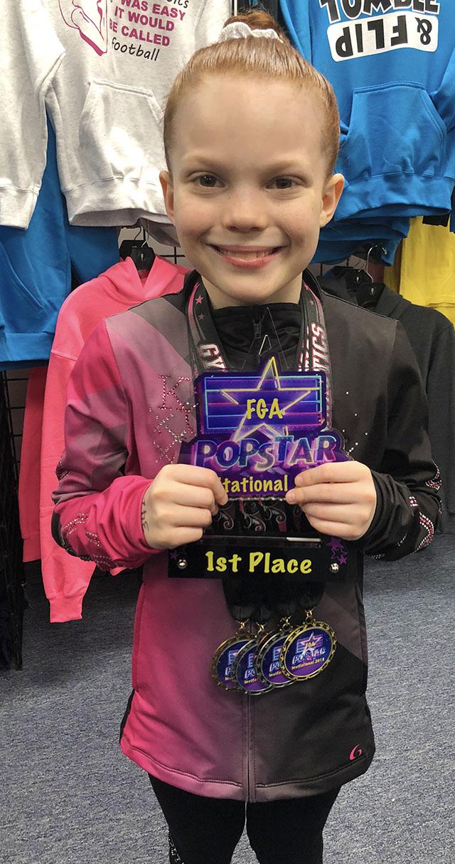 Out Scoring 584 Gymnasts Julia Wins All-Around Best