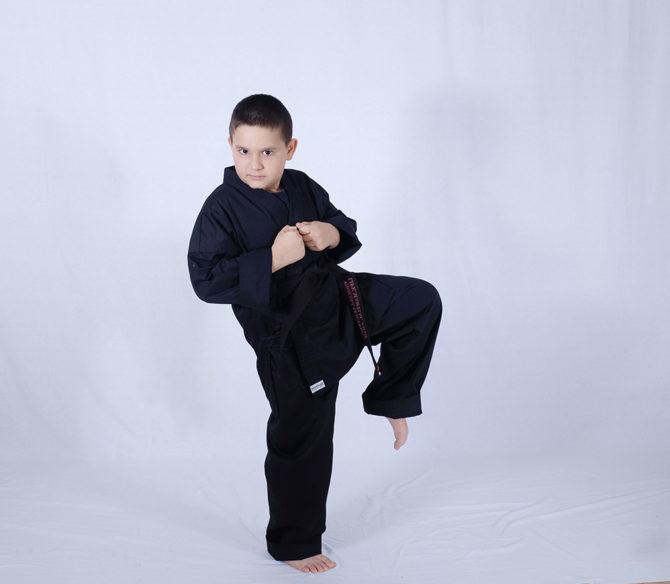 Three Years of Hard Work – Thomas Earns Black Belt