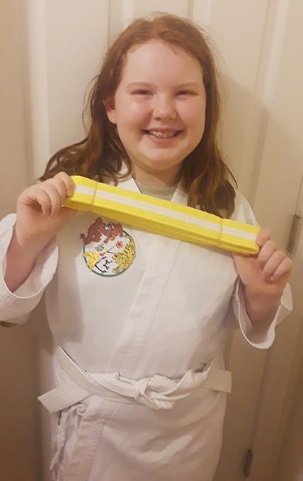 Kasara Skipping Forward Through Her Karate Belts