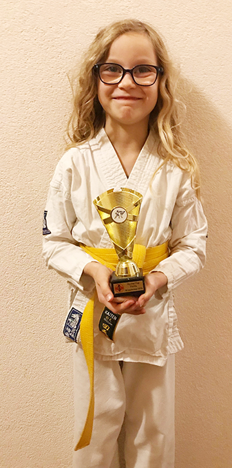 Eva Wins First Trophy, First Prize for Forms