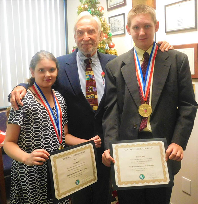Michael and Emily Awarded for 100's of Volunteer Hours