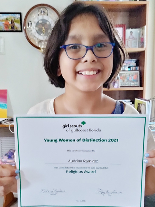Brownie Audrina Receives Girl Scouts Religious Award