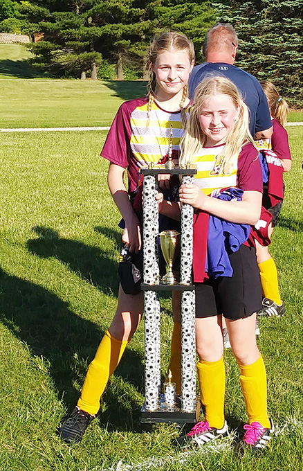 Sisters Team Up to Win Soccer League Tournament